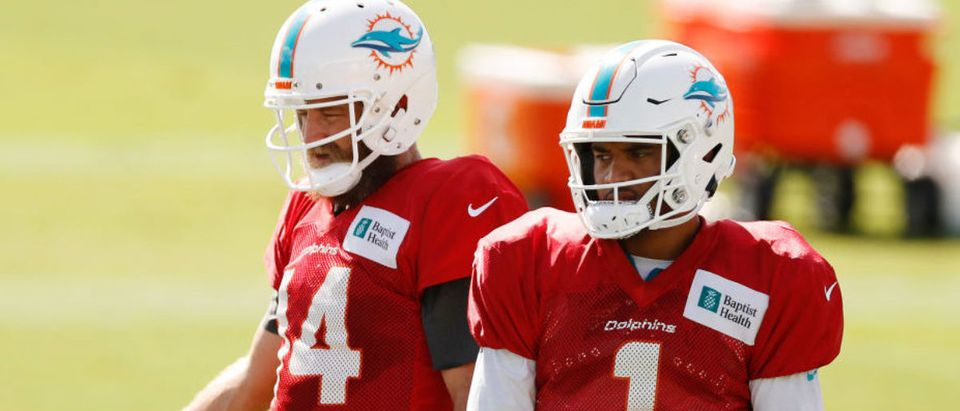 DAVIE, FLORIDA - AUGUST 18: Ryan Fitzpatrick #14 and Tua Tagovailoa #1 of the Miami Dolphins look on during training camp at Baptist Health Training Facility at Nova Southern University on August 18, 2020 in Davie, Florida. (Photo by Michael Reaves/Getty Images)