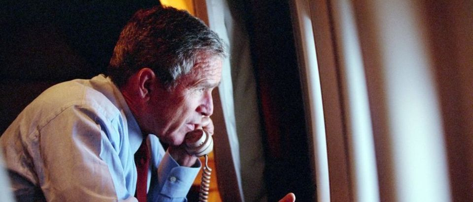 In this photo released by The White House 16 September, 2001, US President George W. Bush speaks by phone from Air Foce One with US Vice President Dick Cheney after departing Offutt Air Force Base in Nebraska, 11 September, 2001. Bush, who was travelling in Louisiana, was flown to Offutt after getting the news of the terrorist attacks in Washington and New York. (Photo credit: ERIC DRAPER/AFP via Getty Images)