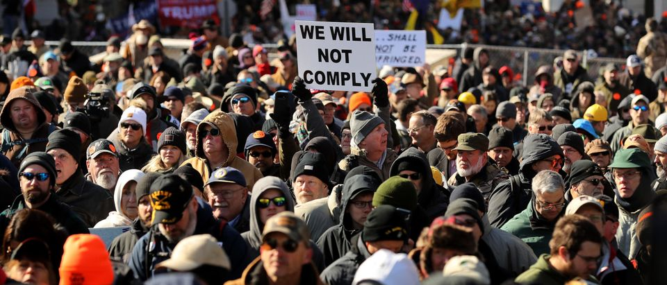 RICHMOND, VIRGINIA - JANUARY 20: Thousands of gun rights advocates attend a rally organized by The Virginia Citizens Defense League on Capitol Square near the state capital building January 20, 2020 in Richmond, Virginia. During elections last year, Virginia Governor Ralph Northam promised to enact sweeping gun control laws in 2020, including limiting handgun purchase to one per month, banning military-style weapons and silencers, allowing localities to ban guns in public spaces and enacting a 'red flag' law so authorities can temporarily seize weapons from someone deemed a threat. While event organizers have asked supporters to show up un-armed, militias and other extremist groups from across the country plan to attend the rally and show their support for gun rights. (Chip Somodevilla/Getty Images)