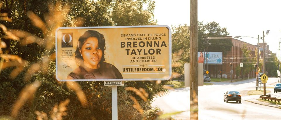 LOUISVILLE, KY - AUGUST 11: A billboard featuring a picture of Breonna Taylor and calling for the arrest of police officers involved in her death is seen on August 11, 2020 in Louisville, Kentucky. Oprah Winfrey's O Magazine sponsored the campaign featuring 26 billboards, one for every year Taylor was alive, across the city of Louisville where she died. Taylor was killed by Louisville Metro Police Department officers in a no-knock raid on March 13 when gunfire erupted. (Jon Cherry/Getty Images)