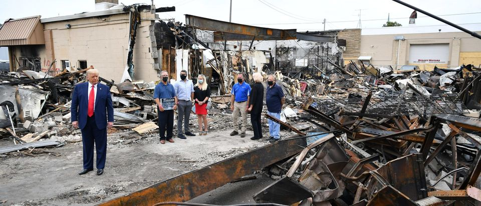 US President Donald Trump (L) tours an area affected by civil unrest in Kenosha, Wisconsin on September 1, 2020. (MANDEL NGAN/AFP via Getty Images)
