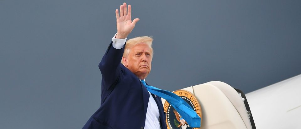 US President Donald Trump makes his way to board Air Force One before departing from Andrews Air Force Base in Maryland on September 3, 2020, heading to Latrobe, Pennsylvania for a campaign stop. - US President Donald Trump on September 3, 2020 renewed his call for supporters to try to vote twice on November 3, a potentially illegal act that he claimed is the only way to be sure that a ballot is counted. (Photo by MANDEL NGAN/AFP via Getty Images)