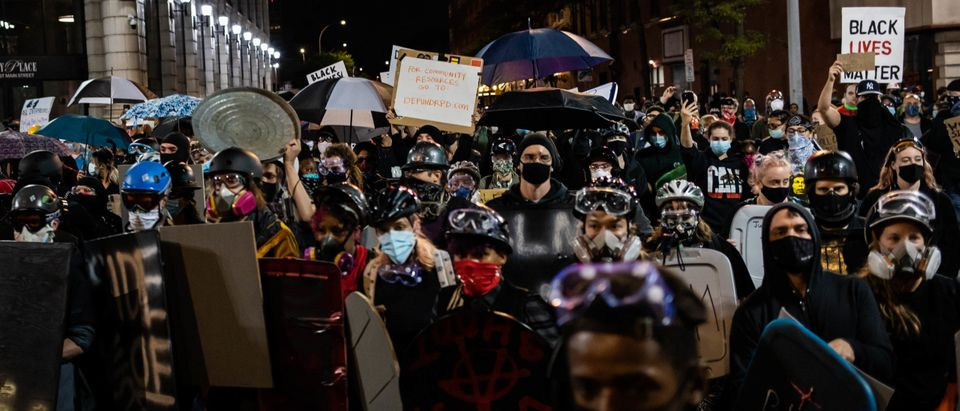 Protesters march for the sixth consecutive night of protest on September 7, 2020, following the release of video evidence that shows the death of Daniel Prude while in the custody of Rochester Police in Rochester, New York. - Prude, a 41-year-old African American who had mental health issues, died of asphyxiation after police arrested him on March 23, 2020 in Rochester, in the state of New York. (MARANIE R. STAAB/AFP via Getty Images)