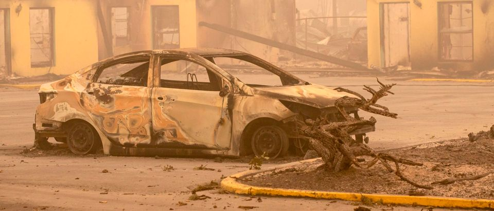 The carcass of a burned car is seen by the Oak Park Motel destroyed by the flames of the Beachie Creek Fire in Gates, east of Salem, Oregon on September 13, 2020. - The wildfire caused the evacuation of 40,000 residents, killing four people and five are still missing (ROB SCHUMACHER/POOL/AFP via Getty Images)
