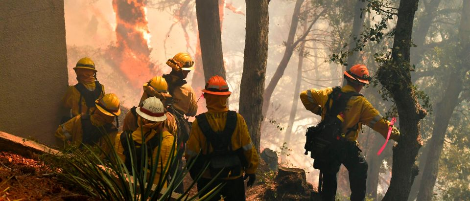 Firefighters work to protect a building at Mt. Wilson Observatory as the Bobcat Fire burns in the Angeles National Forest, northeast of Los Angeles, California on September 17, 2020. - The Bobcat Fire erupted on September 6 near the Cogswell Dam and West Fork Day Use area northeast of Mount Wilson within the Angeles National Forest, expanding from 46,263 acres to 50,539 acres since September 16 while remaining only 3% contained. (Photo by Frederic J. Brown/AFP via Getty Images)