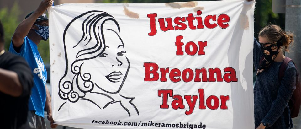 AUSTIN, TX - SEPTEMBER 19: Community members gathered for a Stand 4 Breonna event to demand justice for Breonna Taylor on September 19, 2020 in Austin, Texas. Taylor, 26, was killed by Louisville police officers as she slept in her apartment on March 13, 2020. (Montinique Monroe/Getty Images)