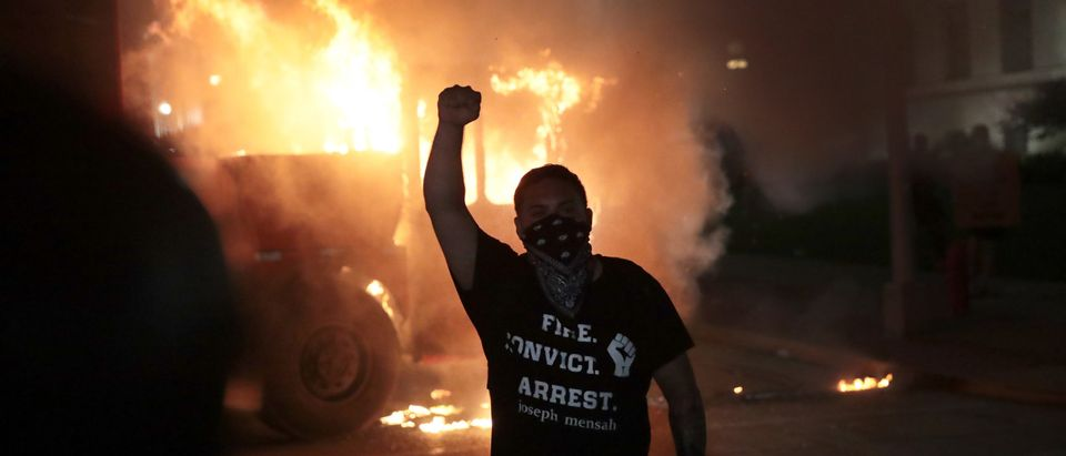 KENOSHA, WISCONSIN - AUGUST 24: Fires burn around downtown during a second night of rioting on August 24, 2020 in Kenosha, Wisconsin. Rioting as well as clashes between police and protesters began Sunday night after a police officer shot Jacob Blake 7 times in the back in front of his three children. (Scott Olson/Getty Images)