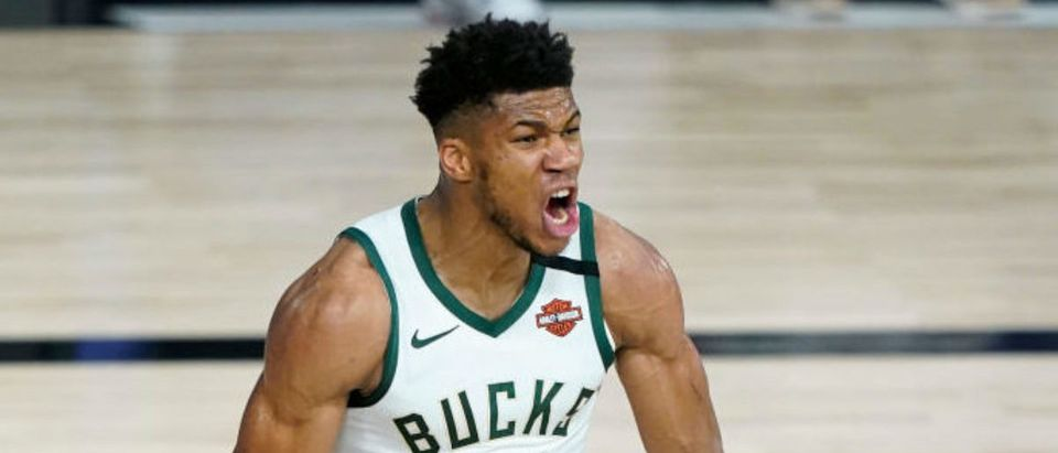 LAKE BUENA VISTA, FLORIDA - AUGUST 20: Giannis Antetokounmpo #34 of the Milwaukee Bucks reacts after scoring against the Orlando Magic during the second half of an NBA basketball first round playoff game on August 20, 2020 in Lake Buena Vista, Florida. (Photo by Ashley Landis - Pool/Getty Images)