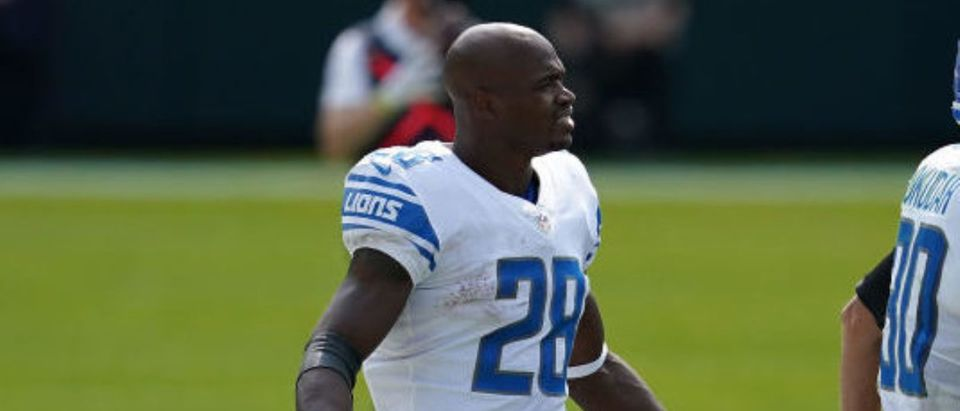 GREEN BAY, WISCONSIN - SEPTEMBER 20: Adrian Peterson #28 of the Detroit Lions reacts to a penalty during the second quarter against the Green Bay Packers at Lambeau Field on September 20, 2020 in Green Bay, Wisconsin. (Photo by Stacy Revere/Getty Images)
