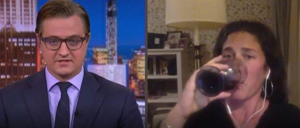MSNBC pundit takes swig on air (MSNBC screengrab)