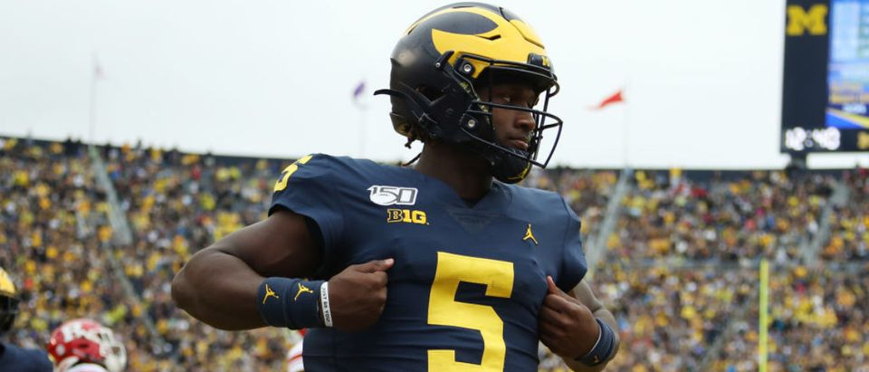 ANN ARBOR, MICHIGAN - SEPTEMBER 28: Joe Milton #5 of the Michigan Wolverines scores a fourth quarter touchdown while playing the Rutgers Scarlet Knights at Michigan Stadium on September 28, 2019 in Ann Arbor, Michigan. (Photo by Gregory Shamus/Getty Images)
