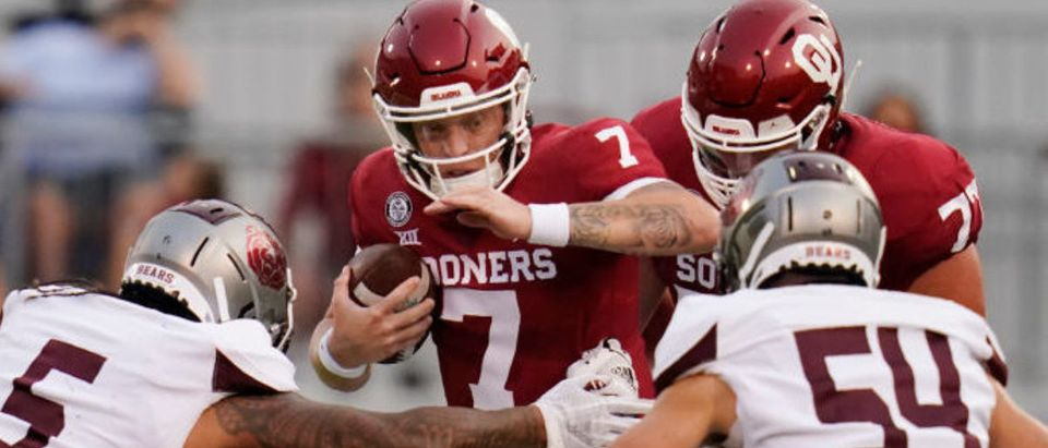 NORMAN, OK - SEPTEMBER 12: Oklahoma quarterback Spencer Rattler #7 carries against Missouri State defenders Ferrin Manulelua #5), Michael Pope #97 and Von Young #54 in the first half of an NCAA college football game on September 12, 2020, in Norman, Oklahoma. (Photo by Sue Ogrocki-Pool/Getty Images)