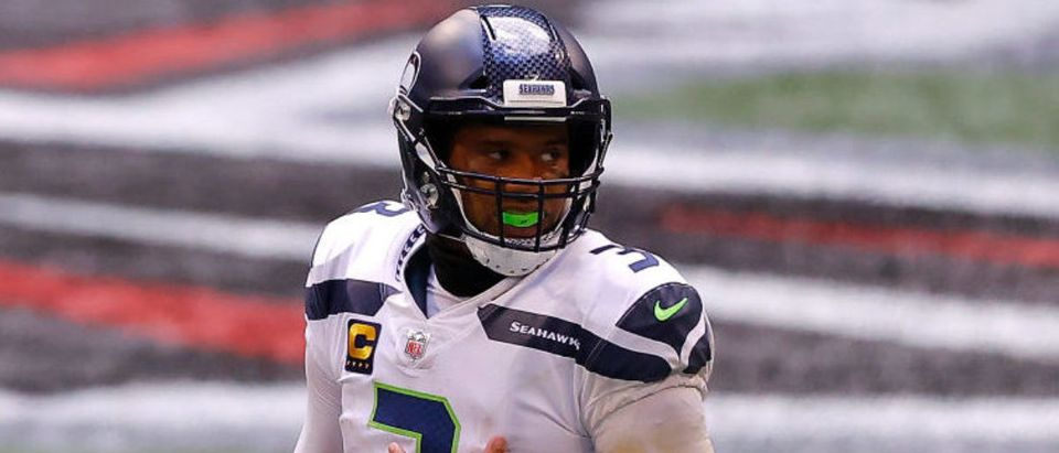 ATLANTA, GEORGIA - SEPTEMBER 13: Russell Wilson #3 of the Seattle Seahawks stands during a timeout against the Atlanta Falcons at Mercedes-Benz Stadium on September 13, 2020 in Atlanta, Georgia. (Photo by Kevin C. Cox/Getty Images)