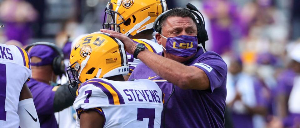 Sep 26, 2020; Baton Rouge, Louisiana, USA; LSU Tigers head coach Ed Orgeron celebrates with safety JaCoby Stevens (7) after a fumble recovery against the Mississippi State Bulldogs during the first half at Tiger Stadium. Mandatory Credit: Derick E. Hingle-USA TODAY Sports via Reuters