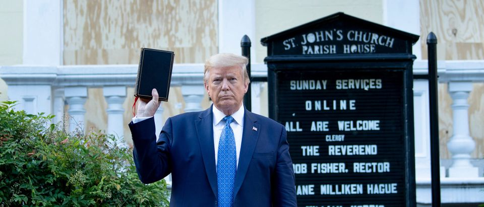 US President Donald Trump holds a Bible while visiting St. John's Church across from the White House. Brendan Smialowski/AFP/Getty Images