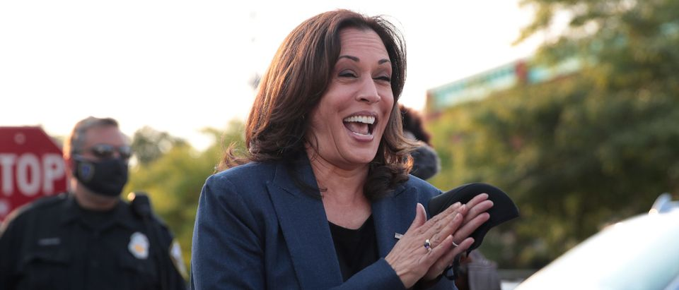 MILWAUKEE, WISCONSIN - SEPTEMBER 07: Democratic Vice Presidential Nominee Sen. Kamala Harris (D-CA) greets supporters gathered outside following a roundtable event with Black business owners on September 7, 2020 in Milwaukee, Wisconsin. Earlier in the day, Harris toured an International Brotherhood of Electrical Workers (IBEW) training facility and met with family members of Jacob Blake. (Photo by Scott Olson/Getty Images)