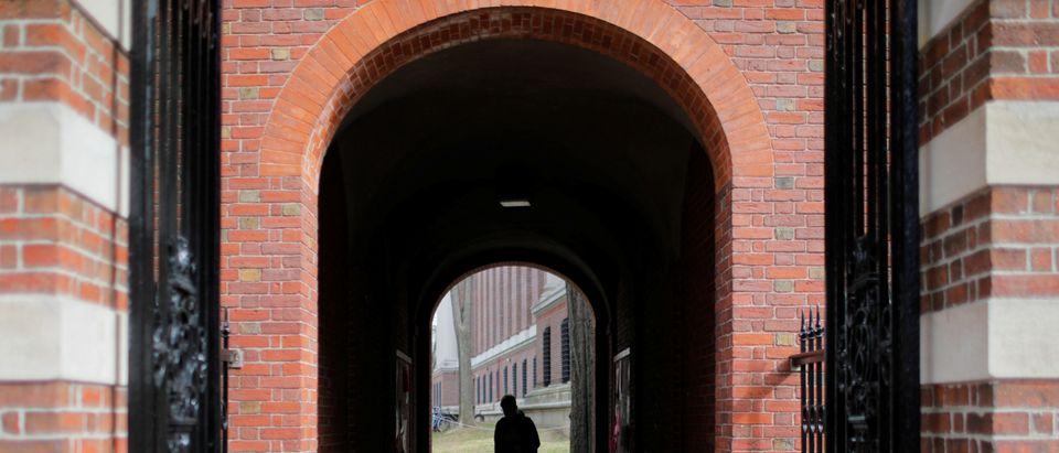 A man walks through a gate to the Yard at Harvard University in Cambridge