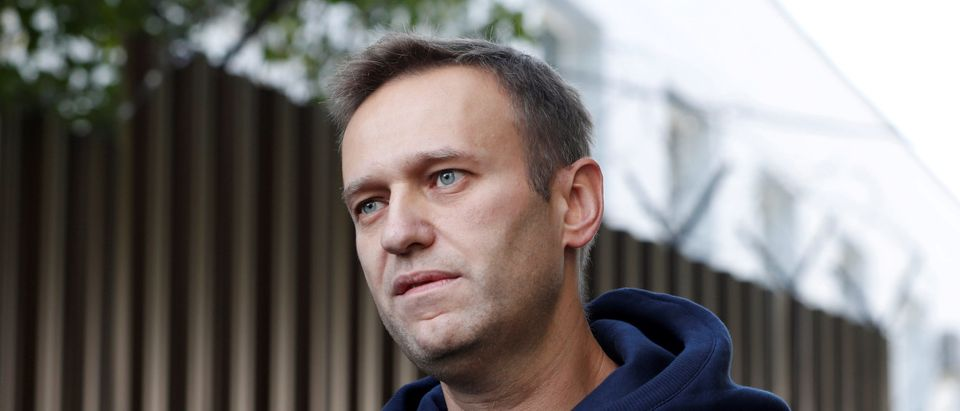Russian opposition leader Navalny speaks with journalists outside a detention centre in Moscow