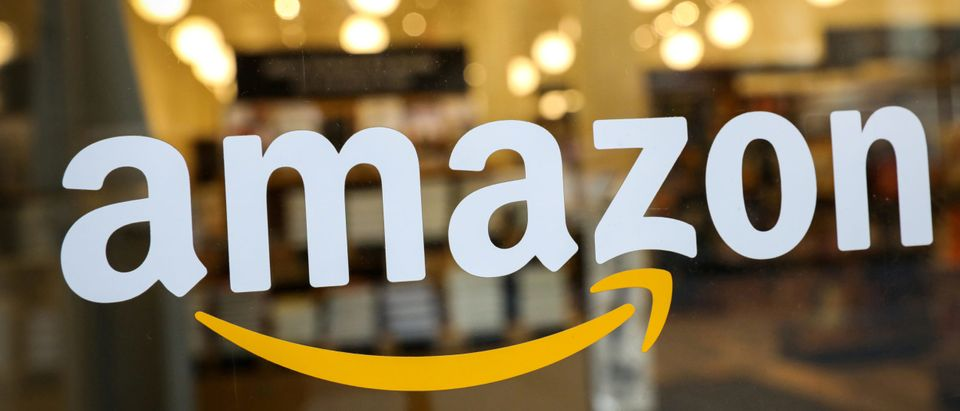 The logo of Amazon is seen on the door of an Amazon Books retail store in New York