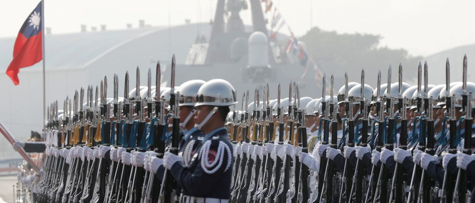 Taiwan's navy sailors take part in a 2018 commissioning ceremony of guided missile frigates, at Kaohsiung's Zuoying naval base