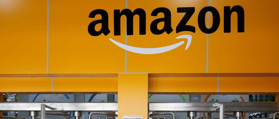 An employee of Amazon walks through a turnstile gate inside an Amazon Fulfillment Centre (BLR7) on the outskirts of Bengaluru