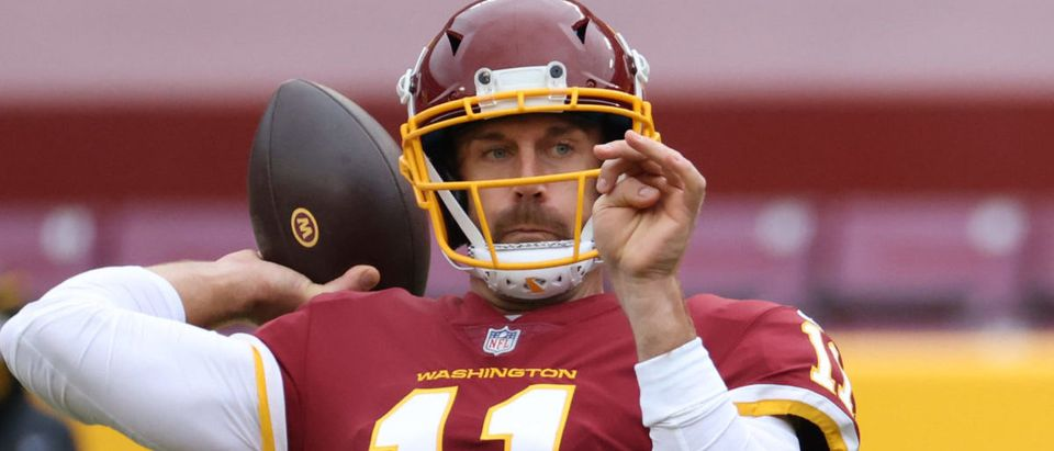 Oct 11, 2020; Landover, Maryland, USA; Washington Football Team quarterback Alex Smith (11) passes the ball during warmups prior to the Washington Football Team's game against the Los Angeles Rams at FedExField. Mandatory Credit: Geoff Burke-USA TODAY Sports via Reuters