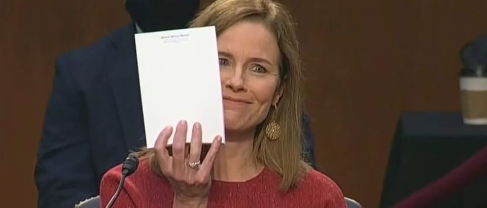 Amy Coney Barrett holds up empty notepad during confirmation hearing (CSPAN screengrab)