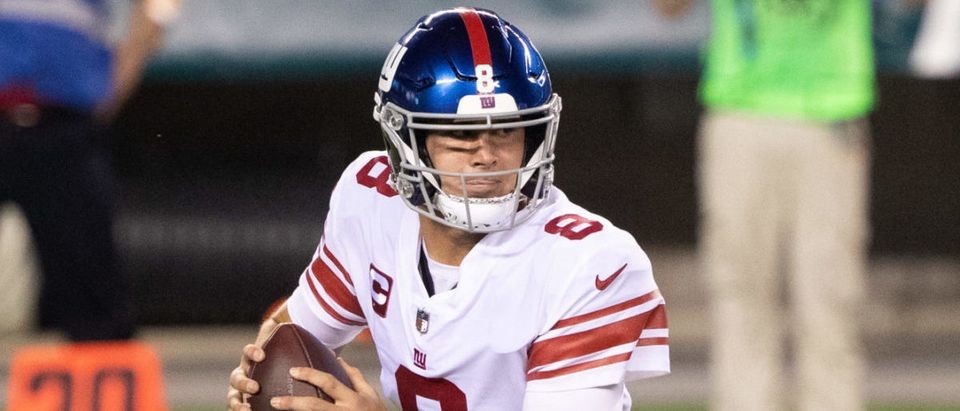 Oct 22, 2020; Philadelphia, Pennsylvania, USA; New York Giants quarterback Daniel Jones (8) rolls out to pass against the Philadelphia Eagles during the first quarter at Lincoln Financial Field. Mandatory Credit: Bill Streicher-USA TODAY Sports via Reuters