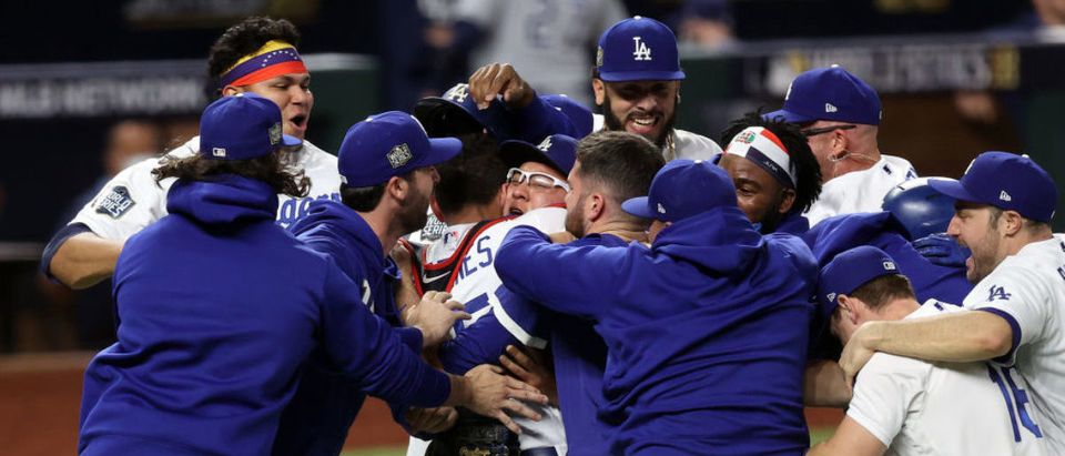 ARLINGTON, TEXAS - OCTOBER 27: The Los Angeles Dodgers celebrate after defeating the Tampa Bay Rays 3-1 in Game Six to win the 2020 MLB World Series at Globe Life Field on October 27, 2020 in Arlington, Texas. (Photo by Tom Pennington/Getty Images)