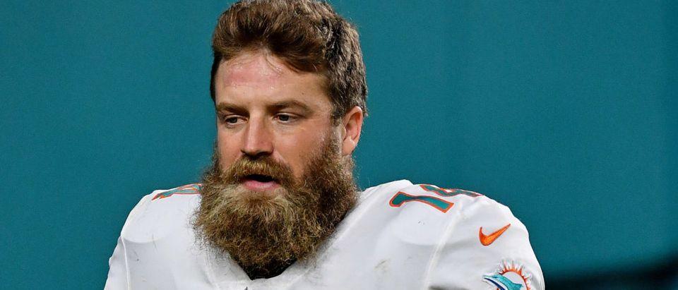Oct 18, 2020; Miami Gardens, Florida, USA; Miami Dolphins quarterback Ryan Fitzpatrick (14) runs off the field after defeating the New York Jets at Hard Rock Stadium. Mandatory Credit: Jasen Vinlove-USA TODAY Sports via Reuters