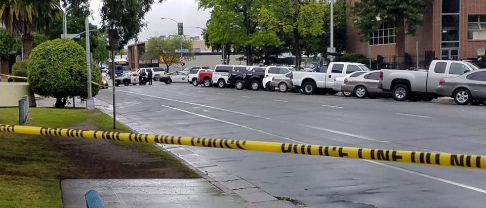 A road is blocked by police tape after a shooting incident in downtown Fresno
