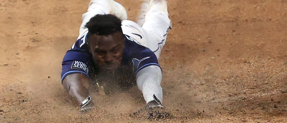 ARLINGTON, TEXAS - OCTOBER 24: Randy Arozarena #56 of the Tampa Bay Rays slides into home plate during the ninth inning to score the game winning run to give his team the 8-7 victory against the Los Angeles Dodgers in Game Four of the 2020 MLB World Series at Globe Life Field on October 24, 2020 in Arlington, Texas. (Photo by Tom Pennington/Getty Images)