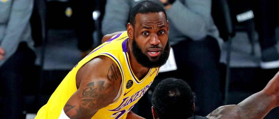 Oct 6, 2020; Miami, Florida, USA; Los Angeles Lakers forward LeBron James (23) handles the ball against Miami Heat guard Andre Iguodala (28) during the second quarter in game 4 of the 2020 NBA Finals at AdventHealth Arena. Mandatory Credit: Kim Klement-USA TODAY Sports via Reuters