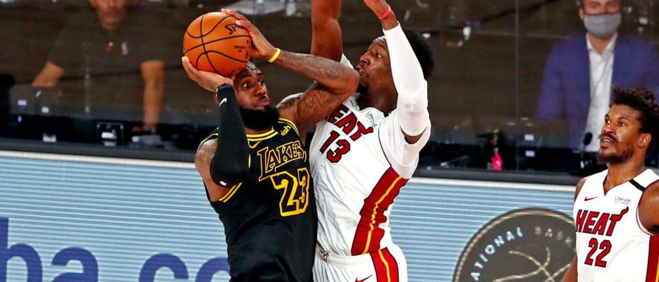 Oct 9, 2020; Lake Buena Vista, Florida, USA; Los Angeles Lakers forward LeBron James (23) shoots a last second shot against Miami Heat forward Bam Adebayo (13) during the fourth quarter in game five of the 2020 NBA Finals at AdventHealth Arena. Mandatory Credit: Kim Klement-USA TODAY Sports via Reuters