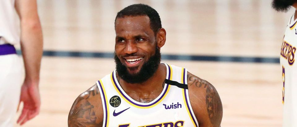 Oct 11, 2020; Lake Buena Vista, Florida, USA; Los Angeles Lakers forward LeBron James (23) smiles after a play against the Miami Heat during the fourth quarter in game six of the 2020 NBA Finals at AdventHealth Arena. The Los Angeles Lakers won 106-93 to win the series. Mandatory Credit: Kim Klement-USA TODAY Sports via Reuters