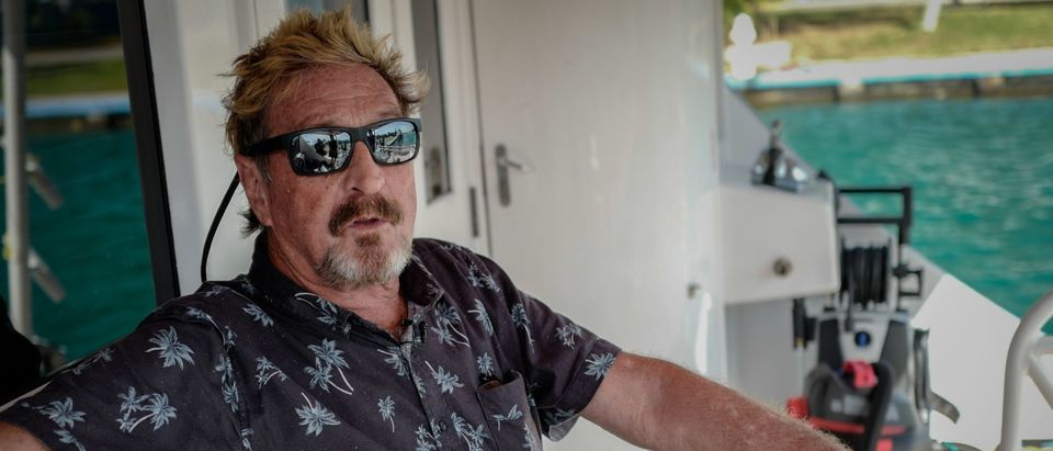 US millionaire John McAfee gestures during an interview with AFP on his yacht anchored at the Marina Hemingway in Havana, on June 26, 2019. - After making his fortune with antivirus software, McAfee fled from Belize after a murder case. (Photo by Adalberto Roque/AFP via Getty Images)