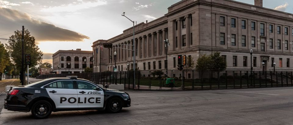 A Kenosha Police car drives past the Kenosha Courthouse surrounded by surrounded by temporary security gates during curfew in Kenosha, Wisconsin on August 31, 2020, following the shooting of Jacob Blake by police. (KEREM YUCEL/AFP via Getty Images)