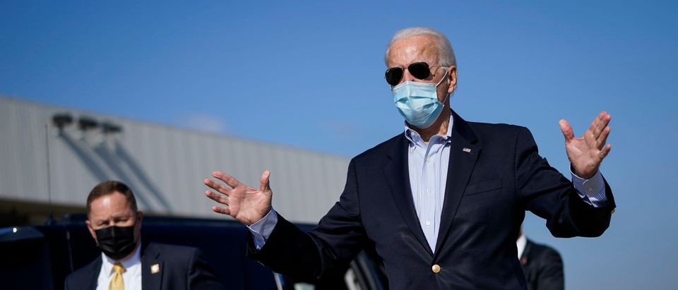 Democratic presidential nominee Joe Biden speaks to reporters before boarding his campaign plane at New Castle Airport on October 22, 2020 in New Castle, Delaware. (Drew Angerer/Getty Images)