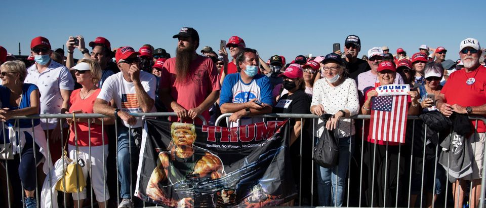 Supporters listen to US President Donald Trump speaking during a Make America Great Again rally at Phoenix Goodyear Airport October 28, 2020, in Goodyear, Arizona. (Photo by Brendan Smialowski/AFP via Getty Images)