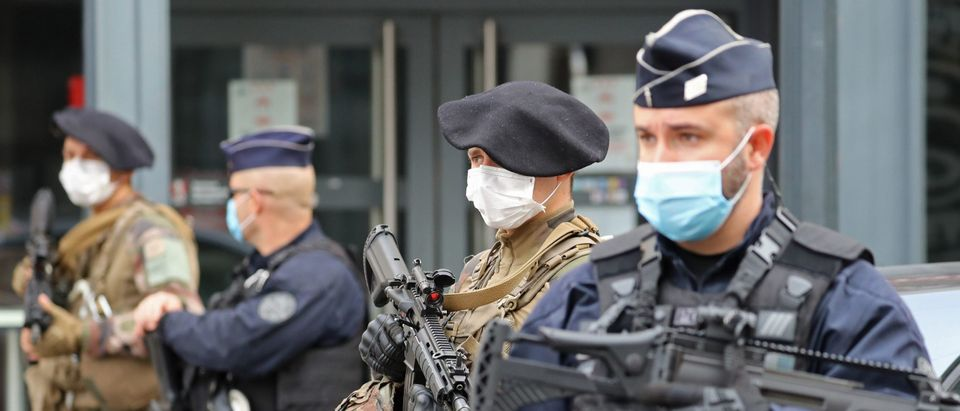 """French soldiers and policemen secure the site of a knife attack in Nice on October 29, 2020. - France's national anti-terror prosecutors said Thursday they have opened a murder inquiry after a man killed three people at a basilica in central Nice and wounded several others. The city's mayor, Christian Estrosi, told journalists at the scene that the assailant, detained shortly afterwards by police, """"kept repeating 'Allahu Akbar' (God is Greater) even while under medication."""" He added that President Emmanuel Macron would be arriving shortly in Nice. (Photo by VALERY HACHE/AFP via Getty Images)"""