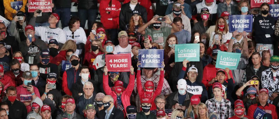 DES MOINES, IOWA - OCTOBER 14: Supporters cheer as President Donald Trump speaks during a rally at the Des Moines International Airport on October 14, 2020 in Des Moines, Iowa. According to a recent poll Trump leads former Vice President Joe Biden by 6 points in the state. (Scott Olson/Getty Images)