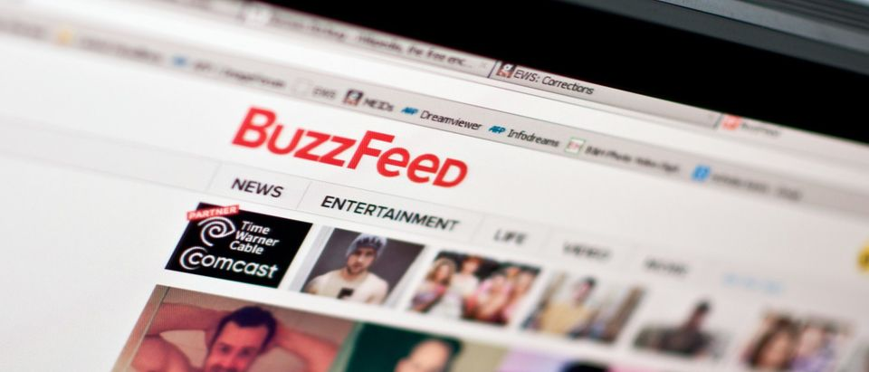 The logo of news website BuzzFeed is seen on a computer screen in Washington on March 25, 2014. (NICHOLAS KAMM/AFP via Getty Images)