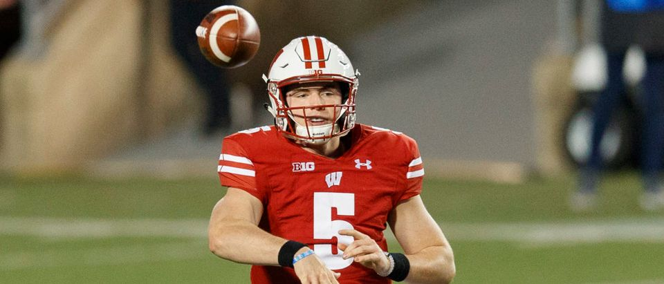 Oct 23, 2020; Madison, Wisconsin, USA; Wisconsin Badgers quarterback Graham Mertz (5) throws a pass during the first quarter against the Illinois Fighting Illini at Camp Randall Stadium. Mandatory Credit: Jeff Hanisch-USA TODAY Sports via Reuters
