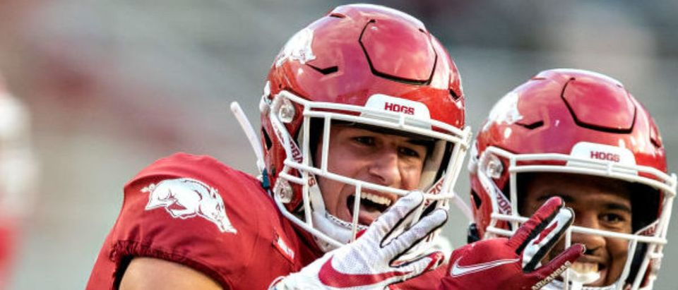 FAYETTEVILLE, AR - OCTOBER 17: Hudson Clark #17 of the Arkansas Razorbacks celebrates with teammate Jalen Catalon #1 after returning a interception for a touchdown in the second of a game against the Mississippi Rebels at Razorback Stadium on October 17, 2020 in Fayetteville, Arkansas. (Photo by Wesley Hitt/Getty Images)