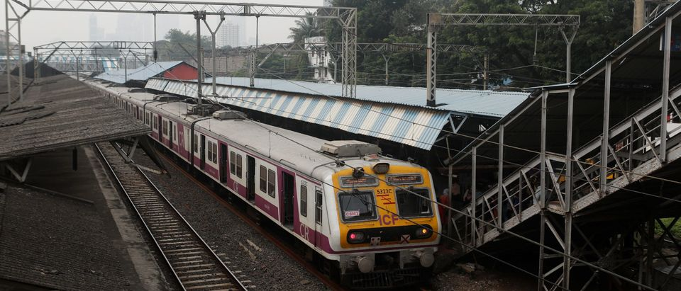 A suburban train is seen stalled at a railway platform during a power outage in Mumbai