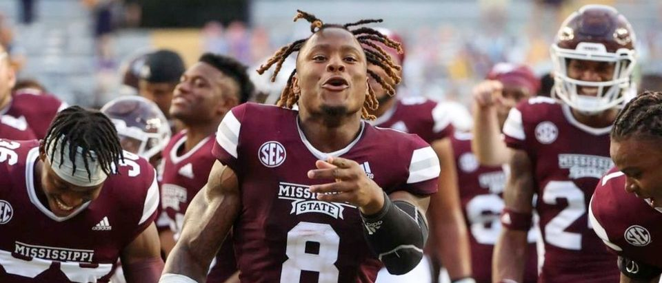 Sep 26, 2020; Baton Rouge, Louisiana, USA; Mississippi State Bulldogs running back Kylin Hill (8) celebrates with cornerback Martin Emerson (1) following a 44-34 win against the LSU Tigers at Tiger Stadium. Mandatory Credit: Derick E. Hingle-USA TODAY Sports via Reuters