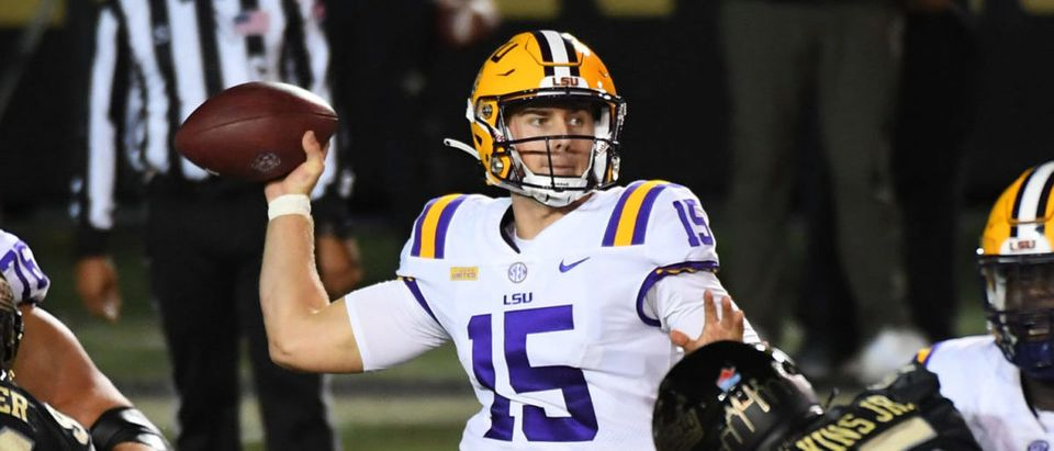 Oct 3, 2020; Nashville, Tennessee, USA; LSU Tigers quarterback Myles Brennan (15) completes a pass during the first half against the Vanderbilt Commodores at Vanderbilt Stadium. Mandatory Credit: Christopher Hanewinckel-USA TODAY Sports via Reuters