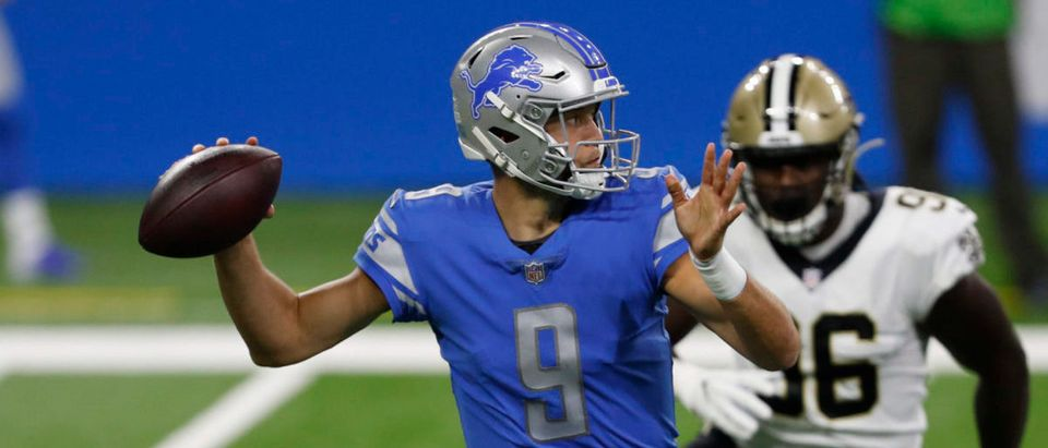 Oct 4, 2020; Detroit, Michigan, USA; Detroit Lions quarterback Matthew Stafford (9) passes the ball as New Orleans Saints defensive end Carl Granderson (96) pressures him during the first quarter at Ford Field. Mandatory Credit: Raj Mehta-USA TODAY Sports via Reuters