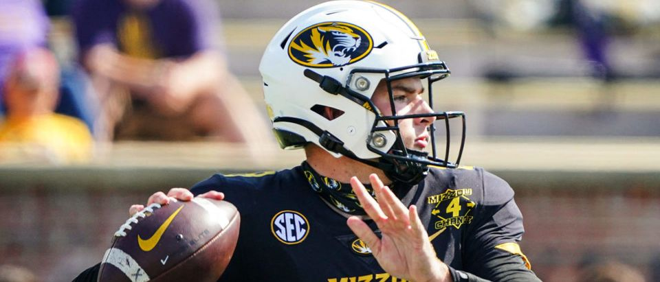Oct 10, 2020; Columbia, Missouri, USA; Missouri Tigers quarterback Connor Bazelak (8) throws a pass against the LSU Tigers defends during the second half at Faurot Field at Memorial Stadium. Mandatory Credit: Jay Biggerstaff-USA TODAY Sports via Reuters