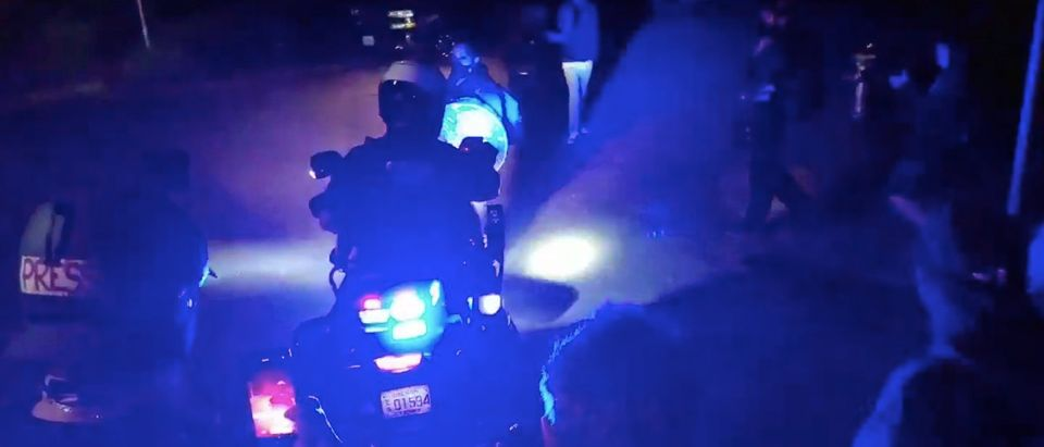 Portland motorcycle officer runs down crowd after being surrounded/Sean Bascom via Twitter